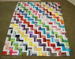Diary of a Crafty Lady: Finished Zig Zag Scrap Quilt & Below is a picture of the quilt top, batting and backing all sewn together  with a fun, swirly, quilting design. Adamdwight.com