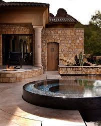 a fire bowl and a hot tub would make your patio a lovely oasis