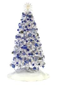 I love the snowy feeling of blue, white and silver for Christmas trees