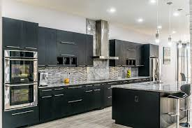 super white marble countertops matched with dark cabinets glass tile and stainless appliances