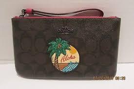 Coach F29418 Large Wristlet Wallet Aloha Motif Signature Brown. Coachc  F29418 Motif Logo Large Wristlet Wallet