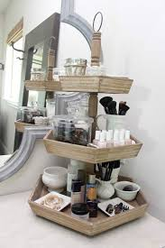 decorative tier holder thingy for makeup/nail supplies.use decorated JARS  on the tiered stand for organized storage