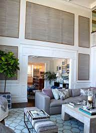 Spacious living room featuring hardwood flooring, gray walls and a tall ceiling. Remodelaholic 24 Ideas On How To Decorate Tall Walls