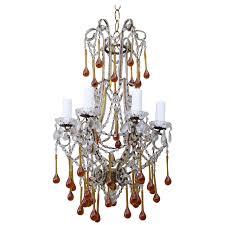 six light amber colored macaroni beaded chandelier