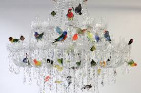 50 multicolored birds adorn the chandelier