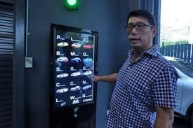 Car Vending Machine Singapore Custom Singapore Car 'vending Machine' Dispenses With Tradition