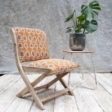 upholstered folding mango wood chair