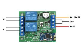 connect the normally open contact n o of relay 1 to the external impulse on terminals of the garage door operator already existing external pulse