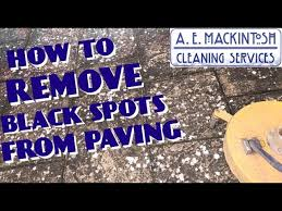 removing black spots from paving you