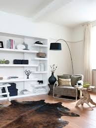 standing lamp with shelves contemporary family room and arc lamp area rug bookcase bookshelves chairs rail cowhide rug decorative pillows display shelves