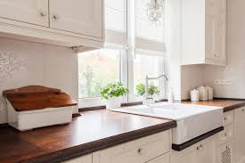 shaker cabinets and farmhouse details make this small country kitchen big on style the furniture style cabinetry and a sink look flawless with the