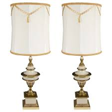 hollywood regency style pair of brass cream colored stiffel table lamps for