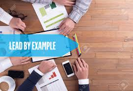 business team working office lead by example desk concept stock business team working office lead by example desk concept stock photo 59054926