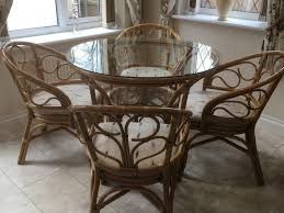 cane glass top circular 38 diameter dining table and four chairs
