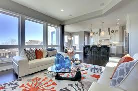 orange rug living room orange and gray area rug living room transitional with blue glass vases orange rug