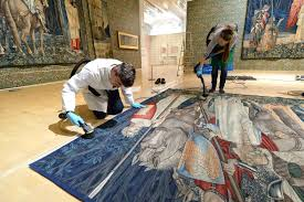 the first ten images show conservation staff at birmingham museum and art gallery cleaning and hanging