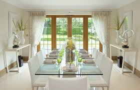 formal dining room curtains. contemporary formal dining room with white chairs, glass table, garden view through doors curtains o