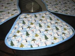 my pal created some wedge place mats for her round table using pre quilted festive fabric