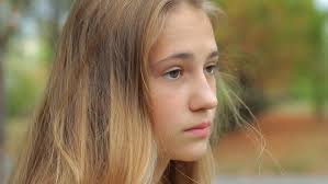 sad face beautiful young looking away outdoors close up profile portrait of ager serious pensive depressed