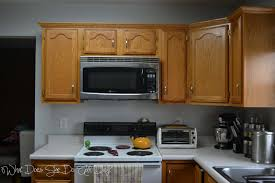 painted brown kitchen cabinets before and after. Painted Kitchen Cabinets Before And After What Does She All Day Wall Colors With Oak Grey Brown