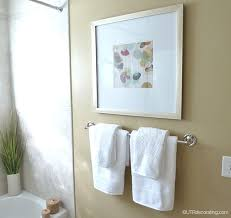 bath towels hanging. Interesting Towels Create A Focal Point The Bathroom By Hanging Picture Above Towel Rack Throughout Bath Towels Hanging 2