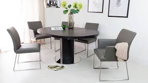 4 comfortable real leather dining chairs and black dining table on ash dining room furniture