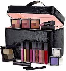 go over the top luxe for the holidays with 19 very y makeup essentials in one chic case great as a gift too