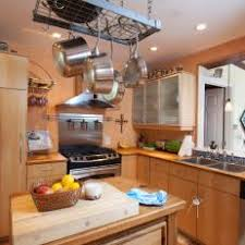 Neutral Kitchen With Industrial Hanging Pot Rack