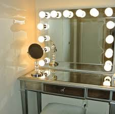 vanity table with lighted makeup mirror