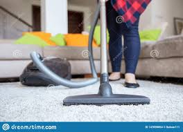 Vacuum With Light Woman Is Cleaning Up The Light Grey Carpet With Vacuum Stock