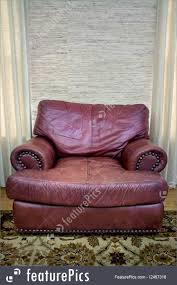 house living comfortable red leather seat in a room in between two windows