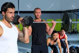 weight group gym group with weight lifting bar and dumbbells workout in crossfit