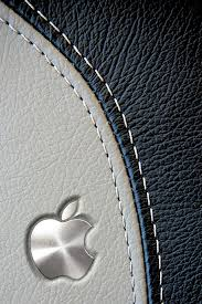 Metal Apple Logo On Leather Background