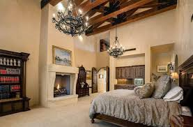 mediterranean bedroom furniture. tan mediterranean bedroom with fireplace exposed beams and vaulted ceiling furniture m