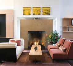 view in gallery family room sports a gorgeous fireplace with glass doors
