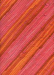 diagonal swatch of warm colored striped rug close up of texture high resolution photo by brankavv