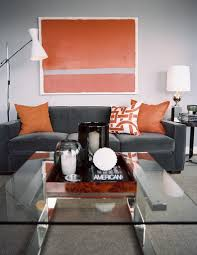 urban decor furniture. Urban Decor Photo - A Glass-topped Coffee Table Paired With Gray Couch And Orange Pillows; Lonny.com Furniture U