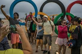 many iers few signs long lines the rio games beyond the tv locals and tourists have stopped by the olympic rings next to the beach volleyball arena at copacabana beach to take photographs credit mauricio lima for
