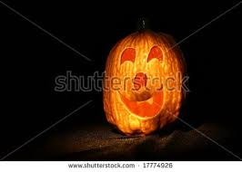 spooky lighting. Halloween Jack O Lantern With Spooky Lighting On Black Satin