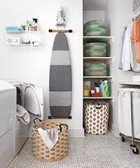 Laundry room with ironing board, large hamper, shelves - Landscape