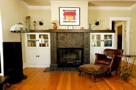 cabinets next to fireplace. traditional enclosed living room idea in san francisco with beige walls cabinets next to fireplace houzz