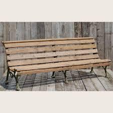 a victorian faux bois garden bench with teak slats