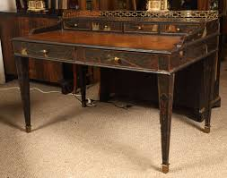 a maitland smith chinoiserie carlton house desk the bronze sabots leading to tapering legs with