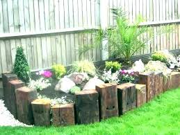 wood landscape ideas wooden flower bed borders vertical railway sleepers yard edging b cedar border flower bed borders ideas