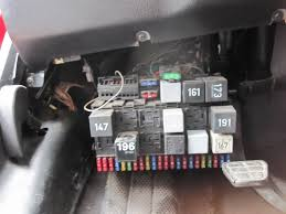 vwvortex com troubleshoot all four power windows suddenly failed picture of the fuse box below anyone know what that silver oval fuse type thing on the top is it s where my diagram says the power window circuit