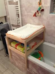view larger over bathtub changing table
