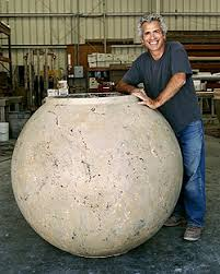 Buddy Rhodes stands next to a 48-inch concrete planter created with a mold  from