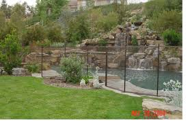 Decorative Pool Fence A Tall Wooden Slat Fence Provides Privacy And Solitude To This