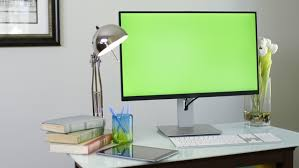 home office desktop 1. Dolly Shot Of Desk With Large Green Screen Monitor. ProResHQ - 4K Stock Video Clip Home Office Desktop 1 L