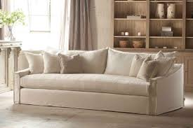 comfortable white slipcovered sofa that brings sophistication in